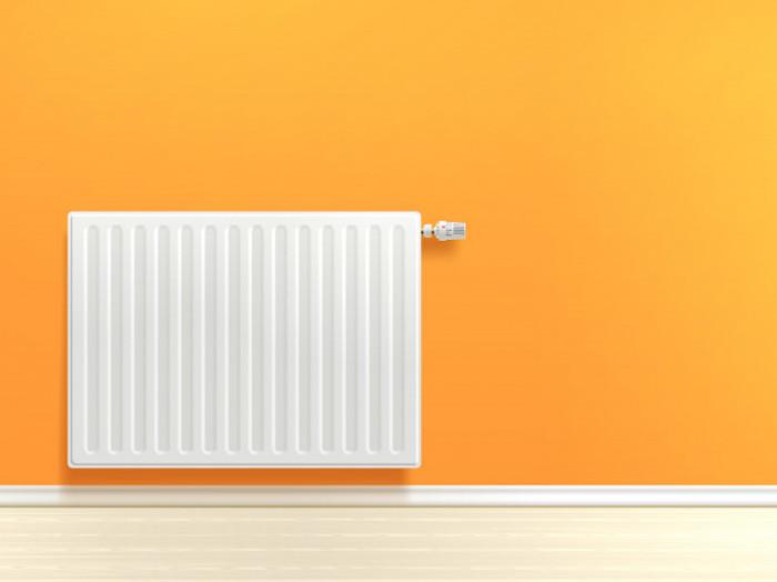 chauffage blanc instale sur un mur orange sol en parquet clair