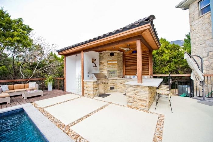 cuisine de jardin angle îlot bar chaises de bar fer forgé terrasse bois meuble jardin canapé d angle