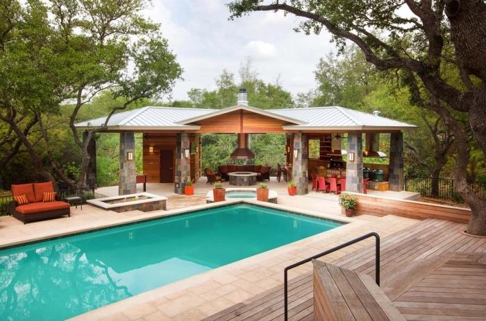 cuisine extérieure couverte revêtement terrasse bois meuble bain soleil éclairage solaire bassin rond