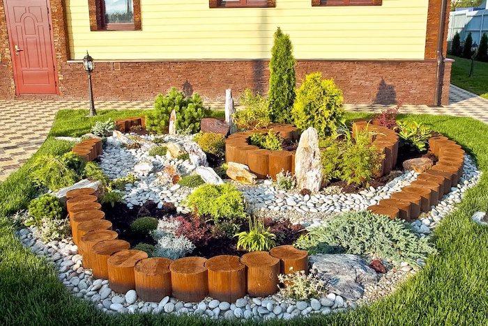 idée bordure jardin recup avec bois galets plantes vertes et des buissons