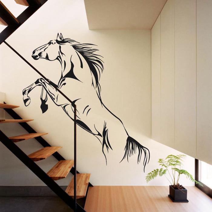 idee deco peinture cage d escalier mur blanc avec sticker de cheval escalier en bois garde corps en métal noir