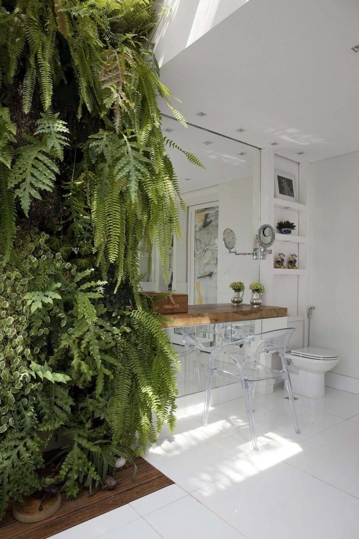 idee deco toilette style nature mur végétal accents bois carrelage blanc rangement vertical étagères