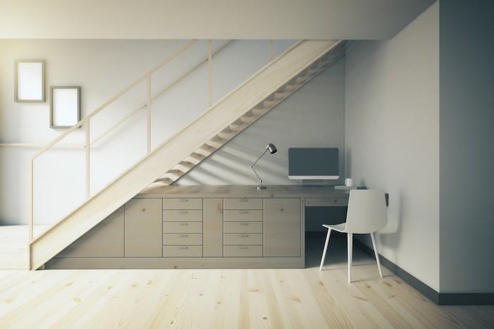 meuble sous escalier en gris chaise blanche style épuré cadre de photos