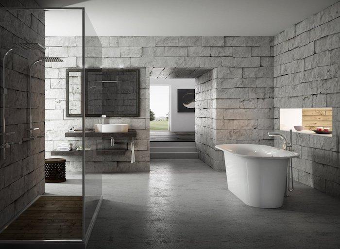 salle de bain travertin sur le sol et pierre naturelle sur les murs accents noirs