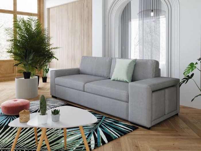 canapé pas cher en gris clair table basse en blanc et en bois tapis en bleu vert et noir