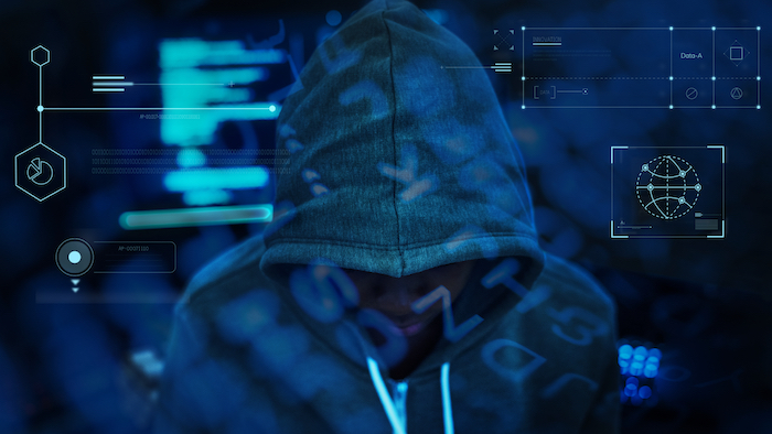 hacker with their hood up