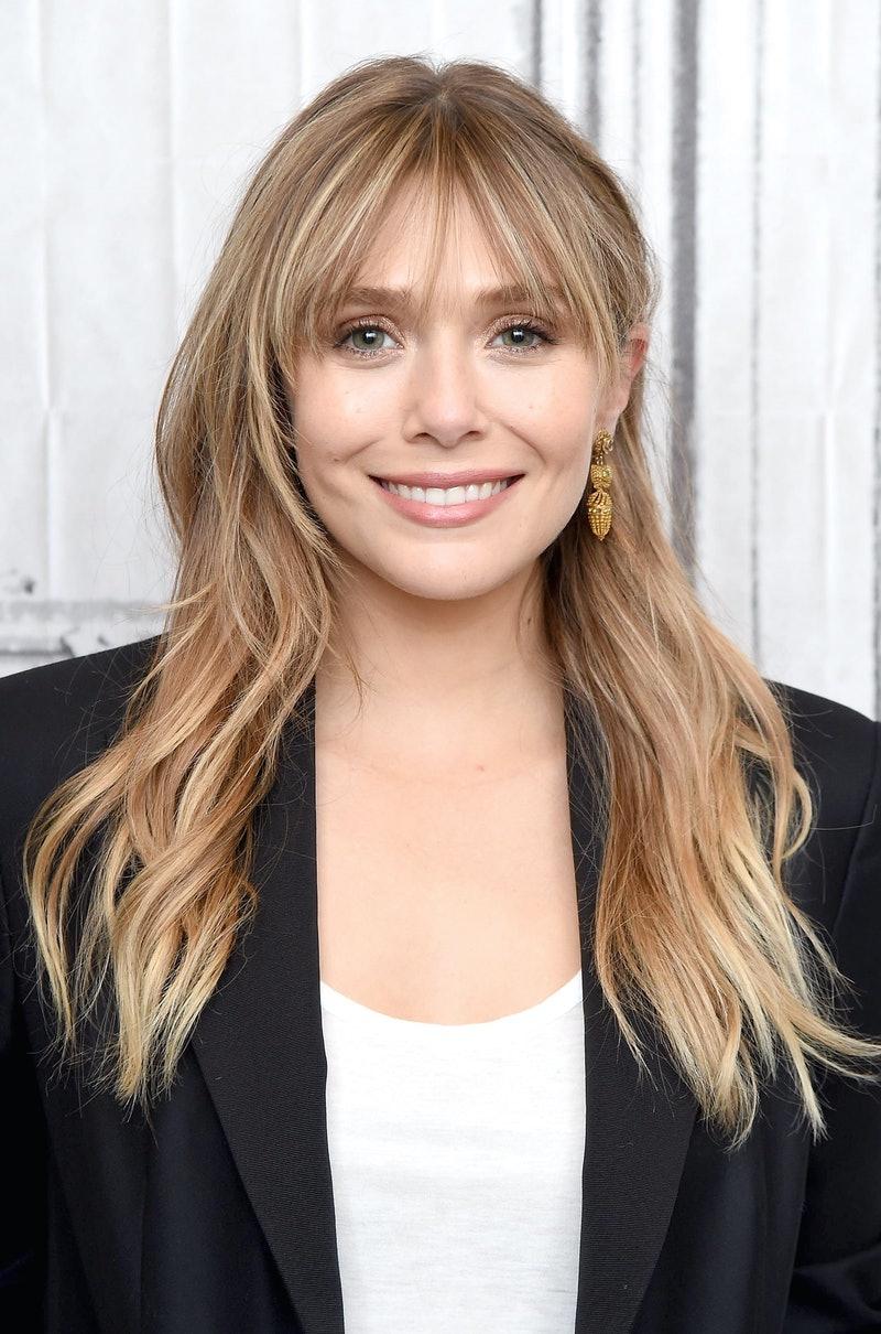 exemple cheveux laché blond dégradé femme 2021 avec frange rideau cheveux bouclés