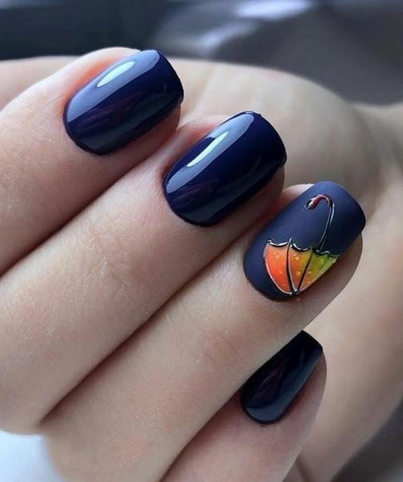 nail art automne parapluie orange sur les ongles blue foncé