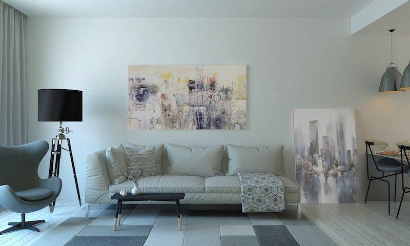 salon avec tapis aux carreaux blanc et gris canape en cuir blanc