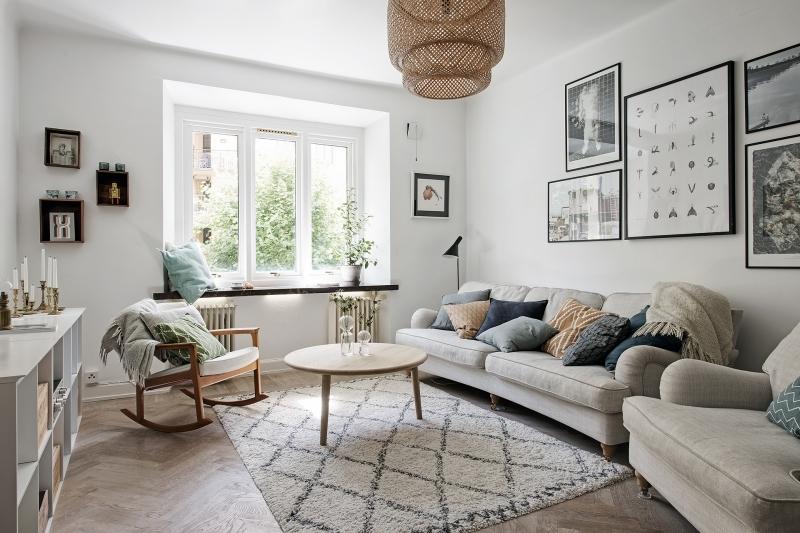 salon style scandinave cocooning tapis berbère frange table bois ronde