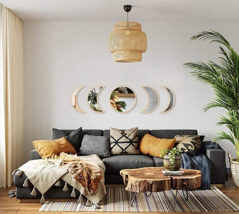 canapé d angle gris anthracite mur de miroir deco lampadaire rotin