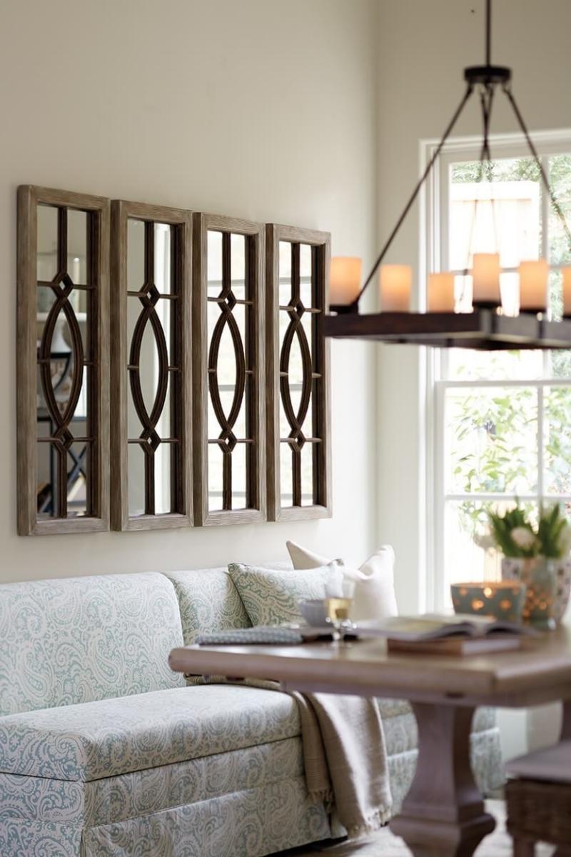 plusieurs miroirs sur un mur meuble canapé miroir cadre bois