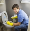 man doing housework, cleaning bathroom toilet